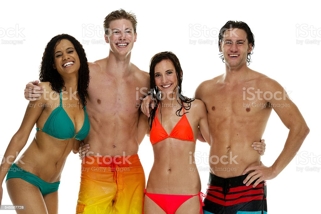 Four friends in swimming clothes and standing stock photo