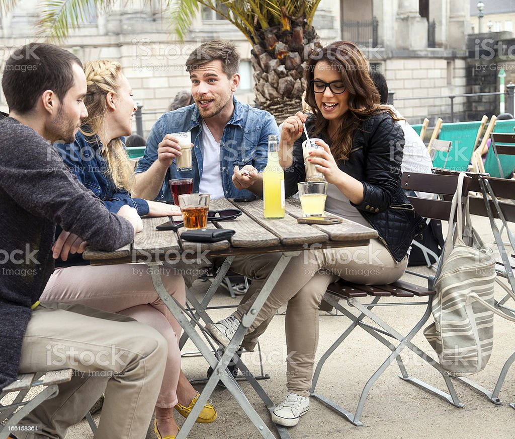 Four Friends Lively Cafe Chat royalty-free stock photo