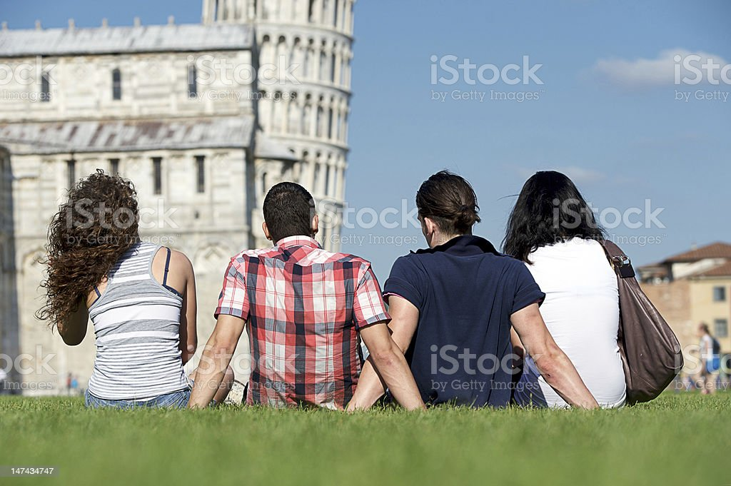 Four Friends on Vacation Visiting Pisa royalty-free stock photo