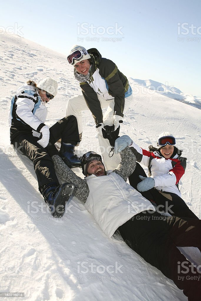 Four Friends Playing in the Snow royalty-free stock photo