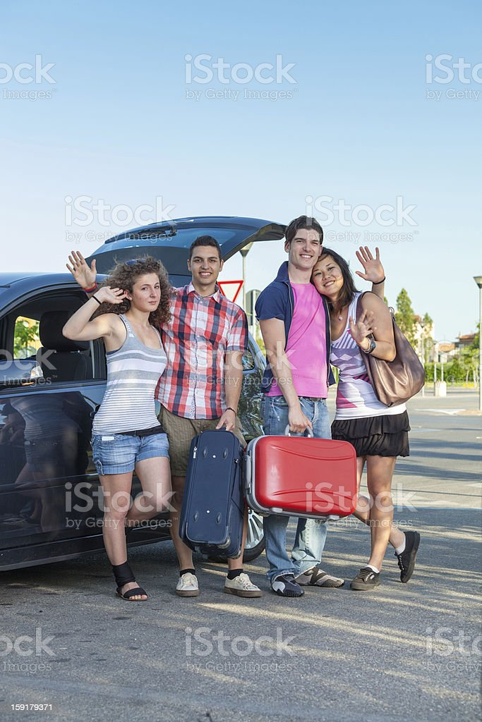 Four Friends Ready to Leave For Vacation royalty-free stock photo