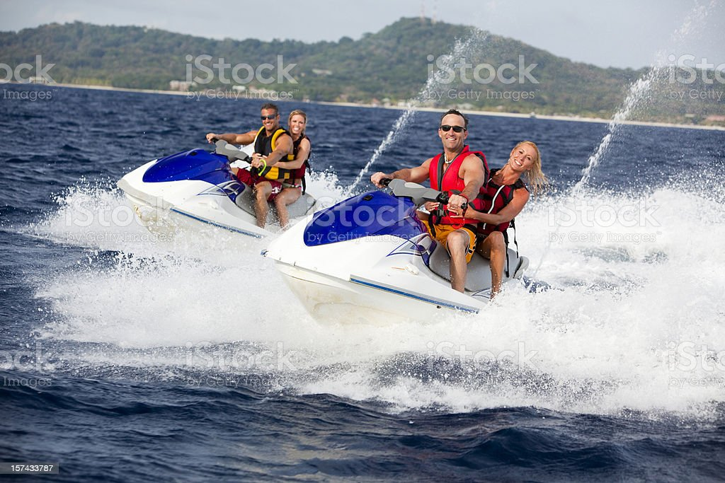 Four Friends ridding jetski personal watercraft royalty-free stock photo
