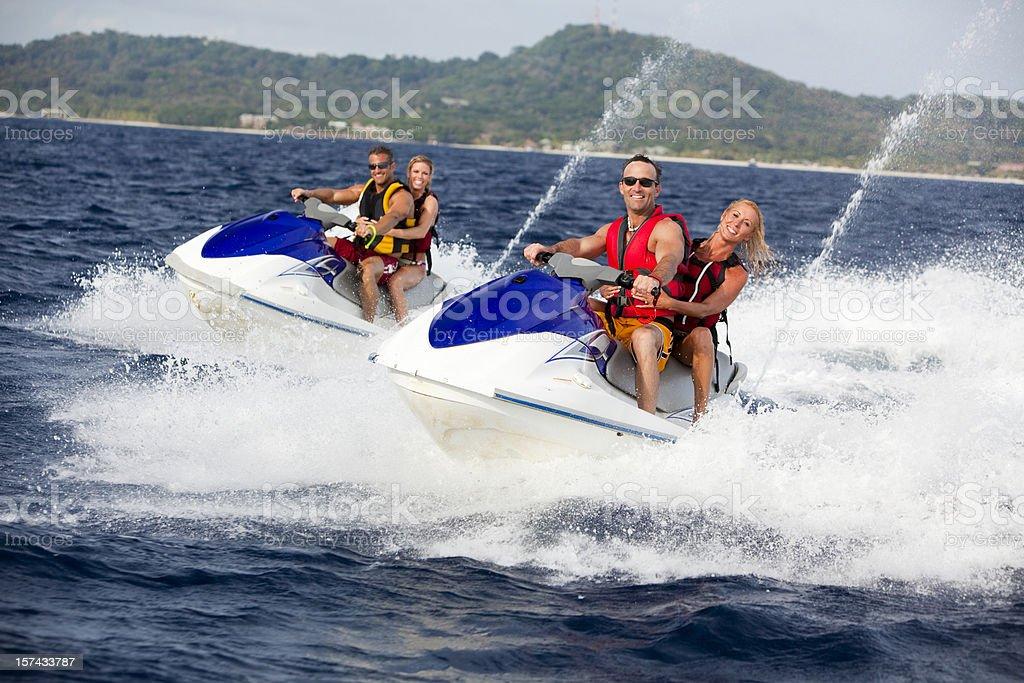 Four Friends ridding jetski personal watercraft stock photo