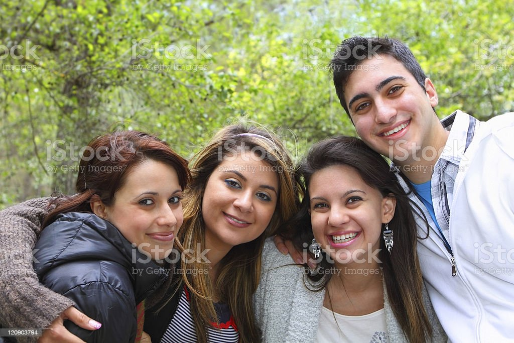 Four Friends Smiling Together royalty-free stock photo