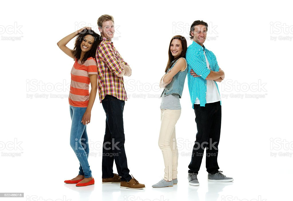 Four friends standing together stock photo