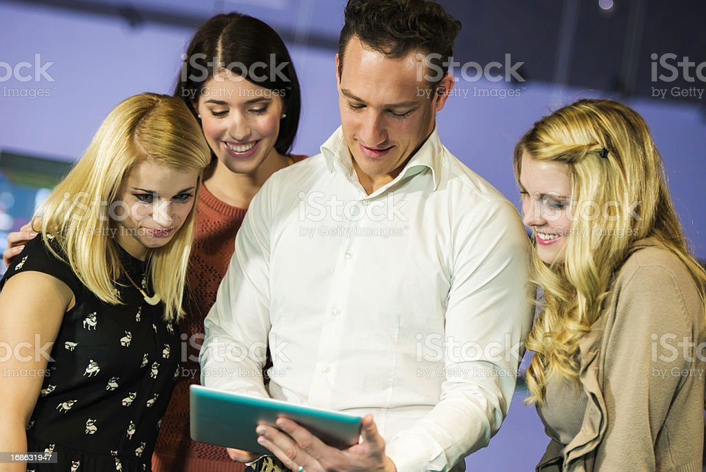 Four friends watching digital tablet royalty-free stock photo
