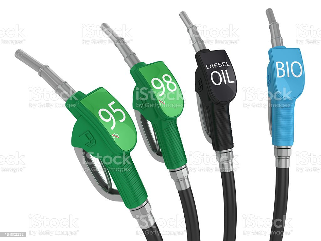 Four fuel pump handles with different fuel grades royalty-free stock photo