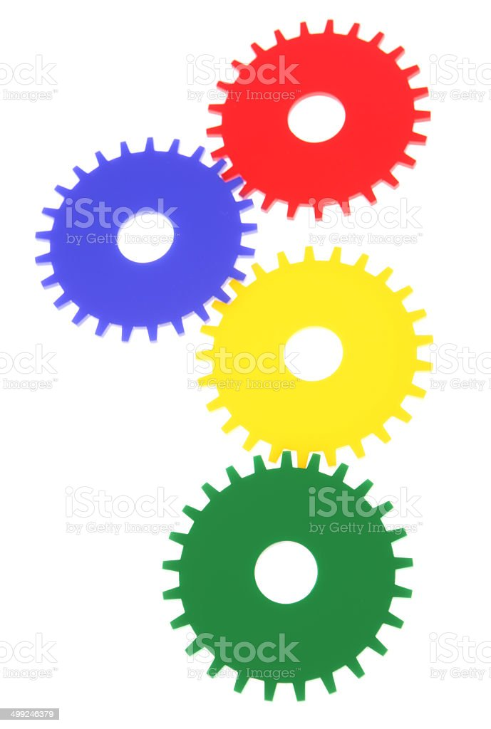 Four Gears Working Together on White Background royalty-free stock photo