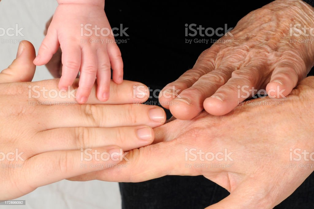 Four generations of female hands royalty-free stock photo