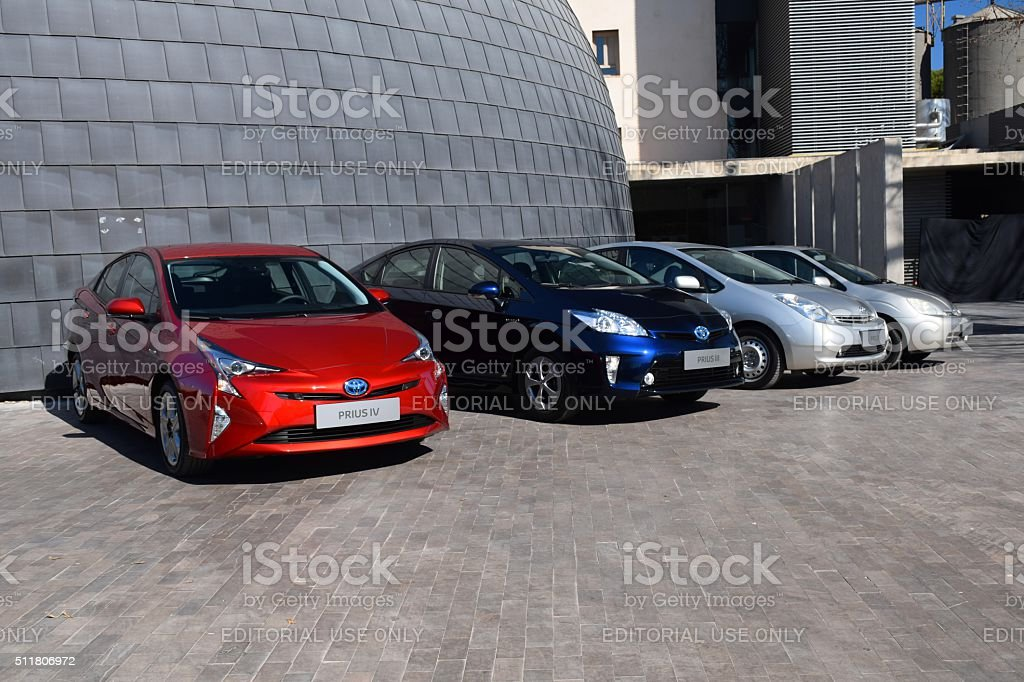 Four generations of Toyota Prius in a row stock photo
