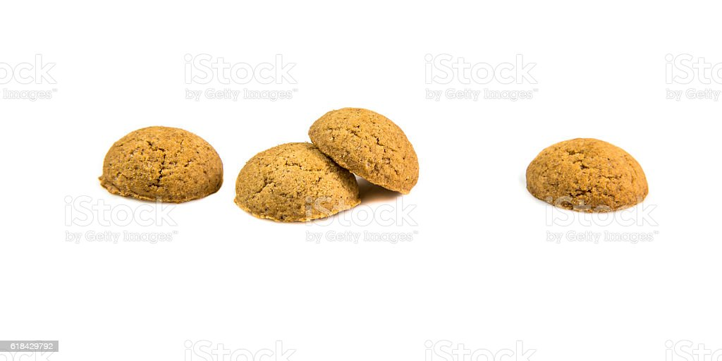 Four ginger nuts in a row stock photo