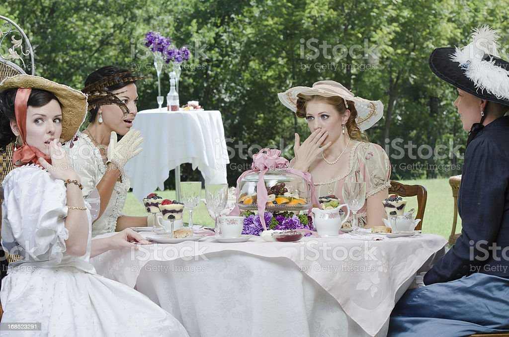 Four girls gossiping royalty-free stock photo