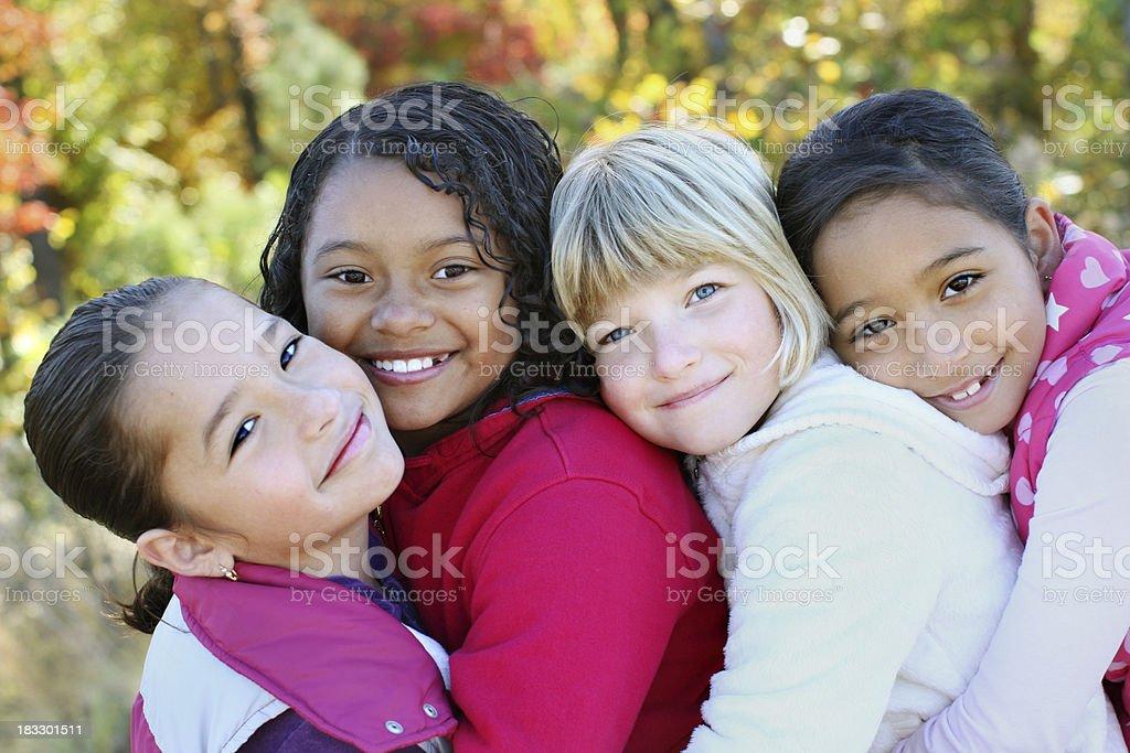 Four girls hugging. stock photo