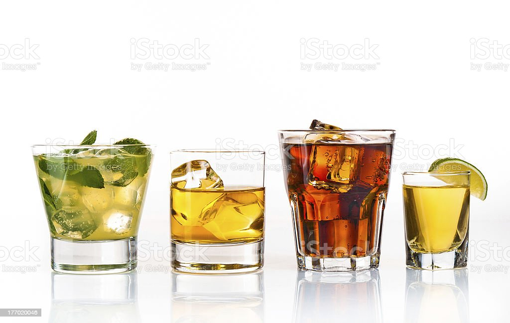 Four glasses of different drinks on white background royalty-free stock photo