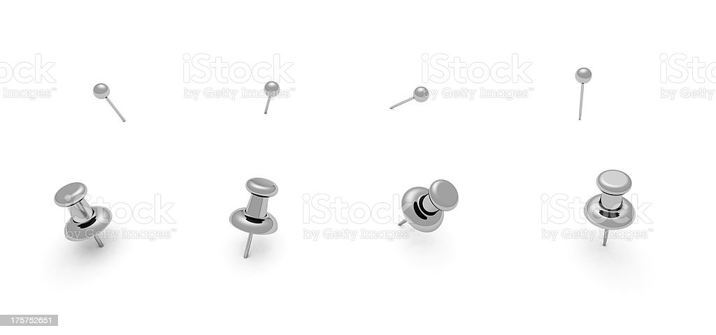 Four gray push pins and four thumb tacks stock photo