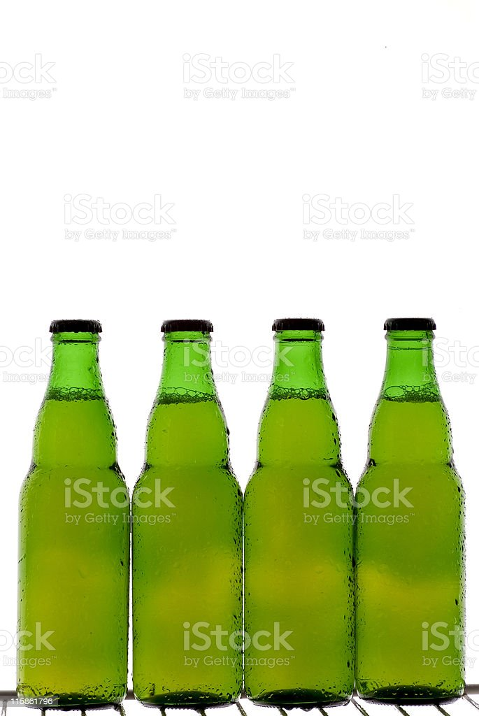 Four green beer bottles royalty-free stock photo