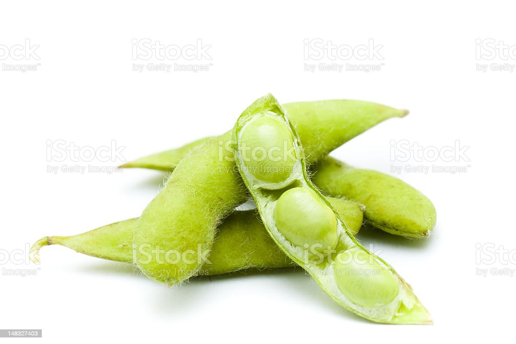 Four green edamame beans with three pods stock photo