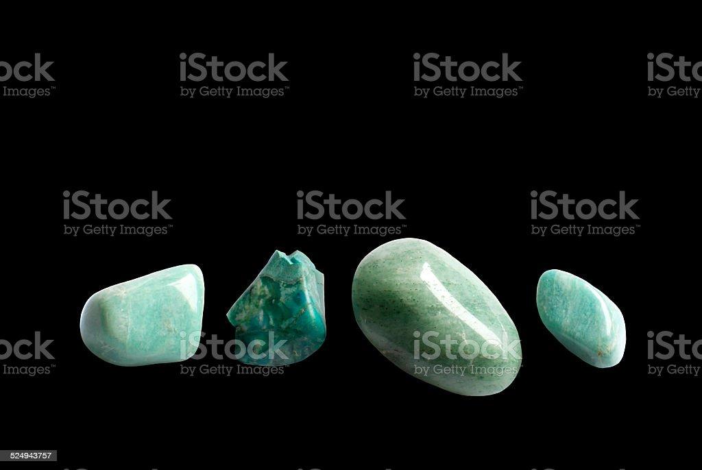 Four green stones stock photo