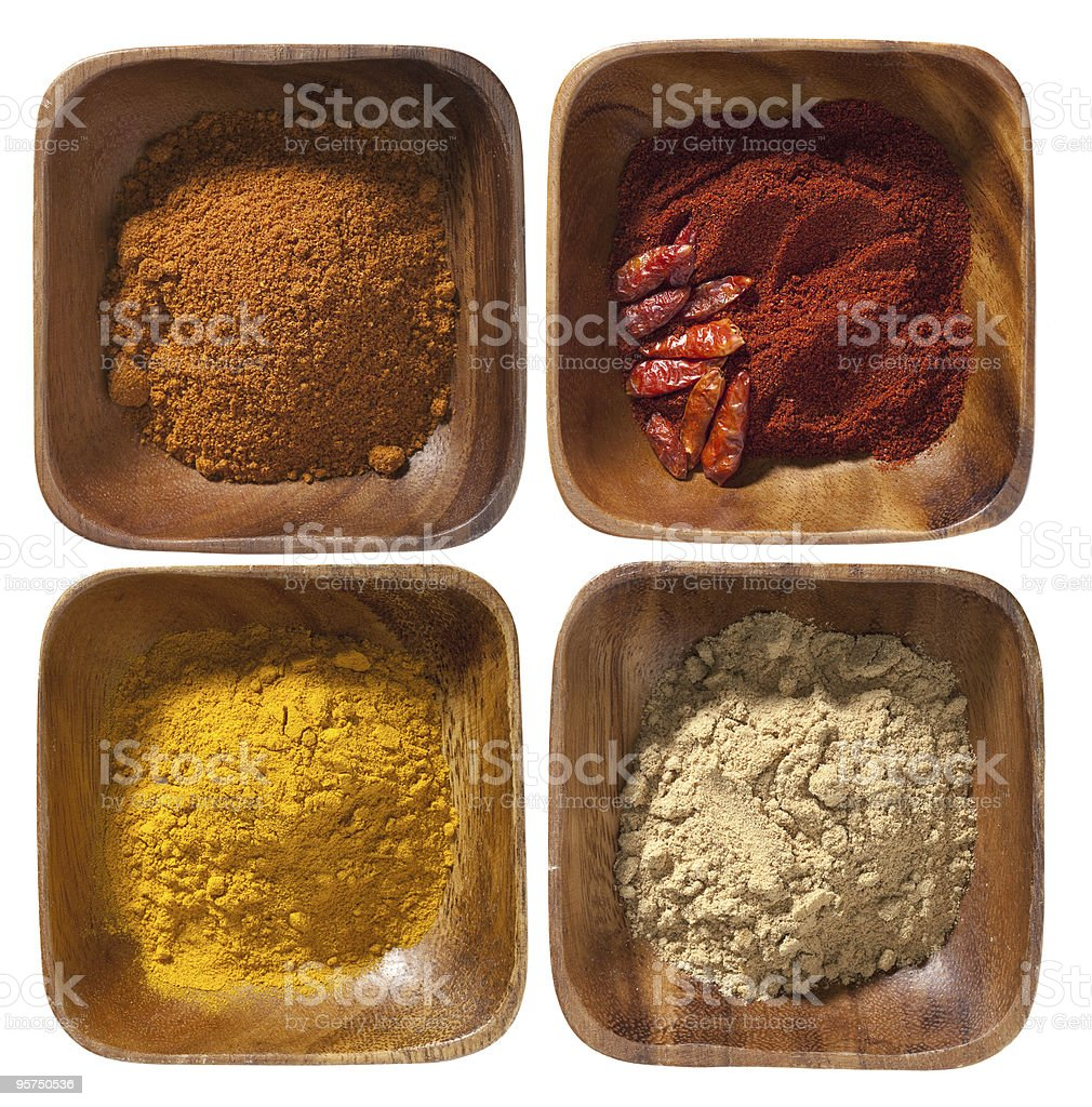 four ground up spices in wooden bowels isolated royalty-free stock photo