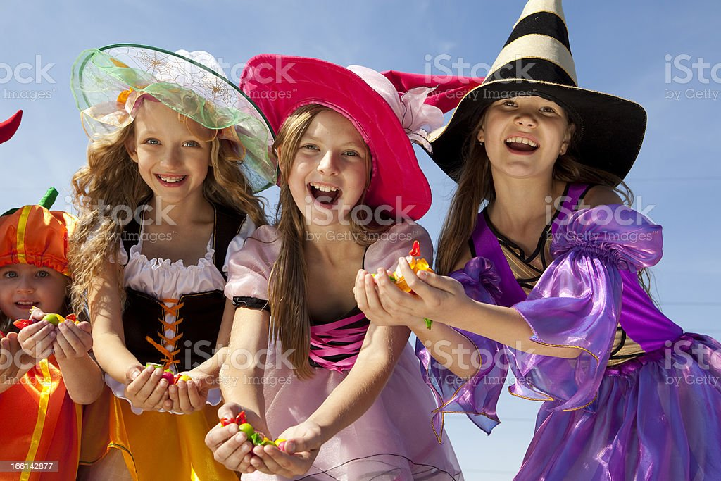 Four Halloween Girls Holding Candies. stock photo