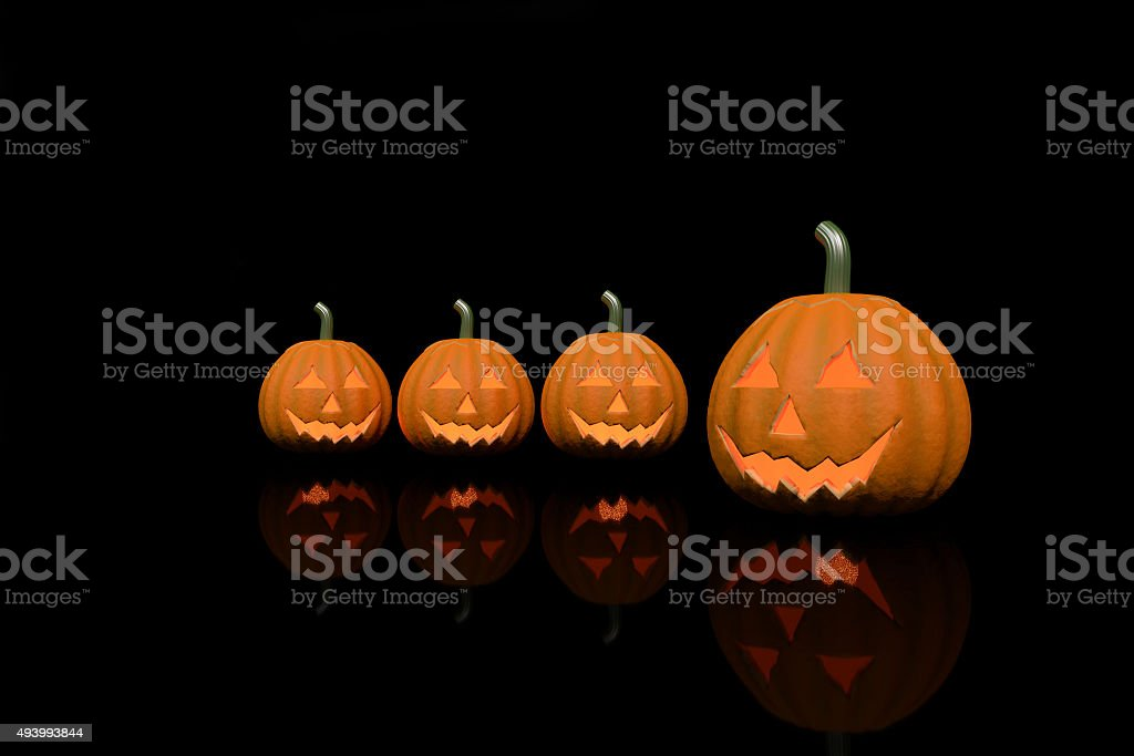 Four halloween pumpkins in black clor background. royalty-free stock photo