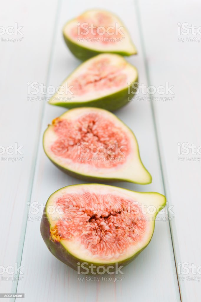 Four halves of fresh figs stock photo