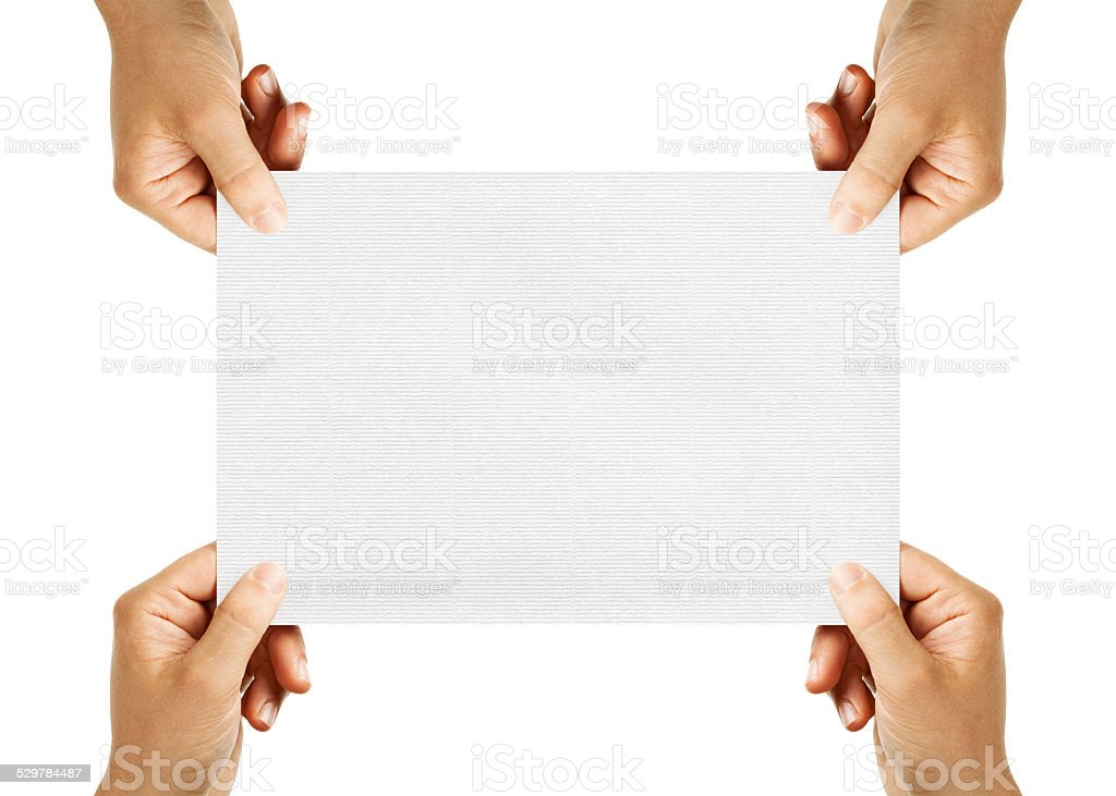 four hands holding sheet of paper stock photo