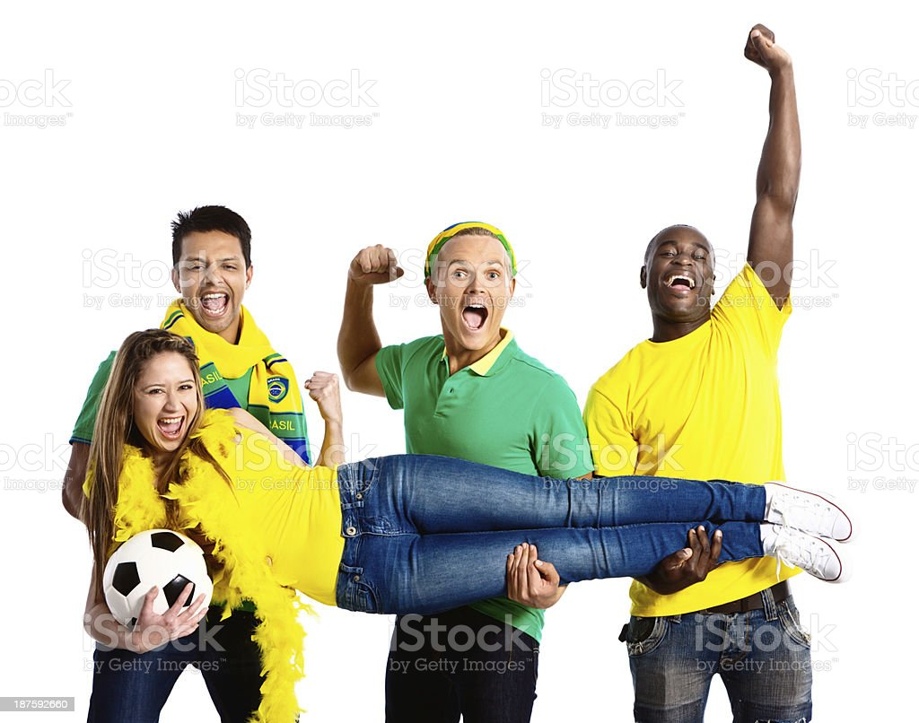Four happy fans in Brazilian colors support world championship royalty-free stock photo