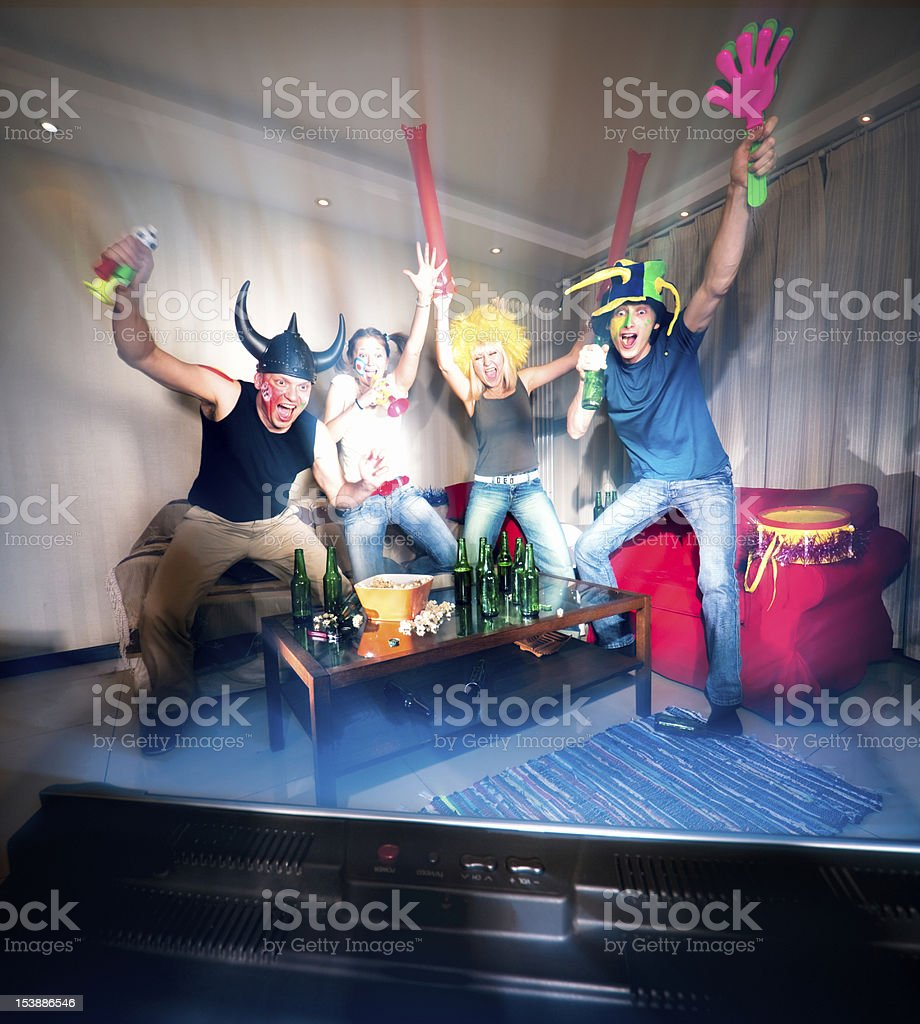 Four happy fans royalty-free stock photo