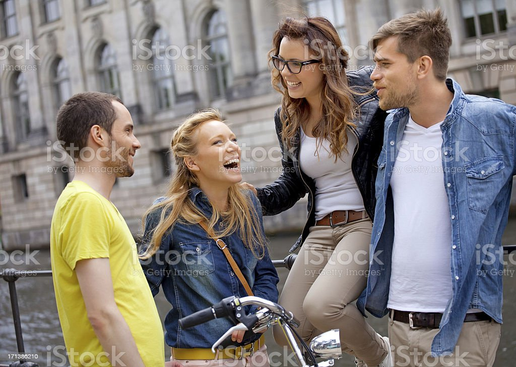 four happy friends in Berlin royalty-free stock photo