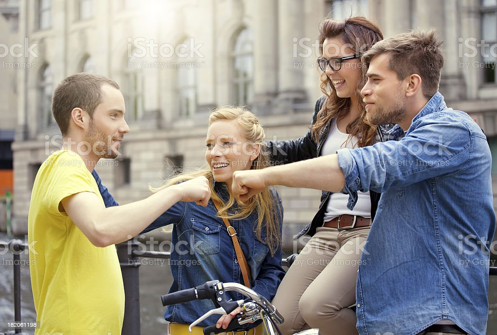 four happy friends meeting in city royalty-free stock photo