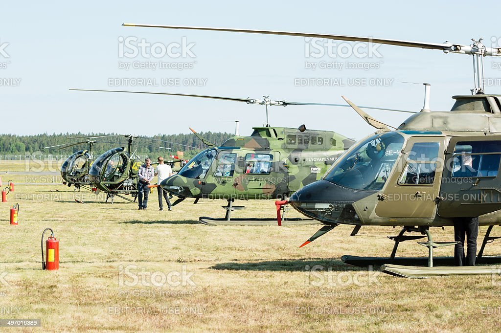 Four helicopters stock photo