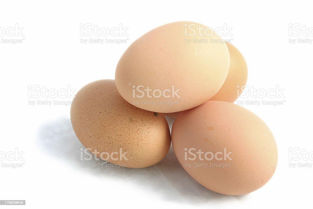 four hens eggs stock photo