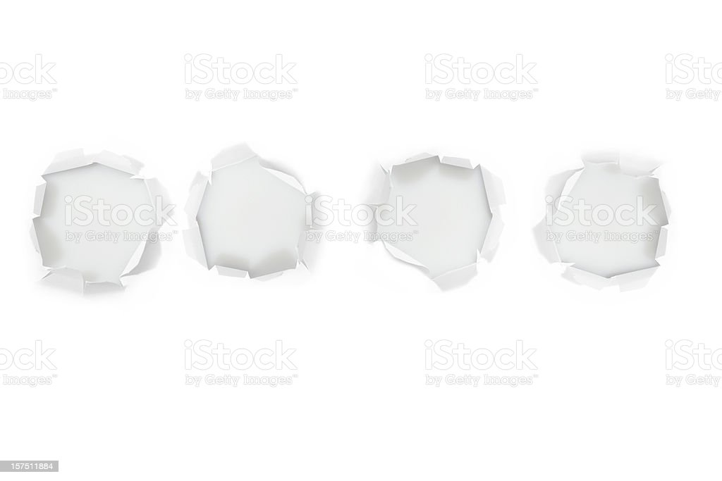 Four hole in a white paper stock photo