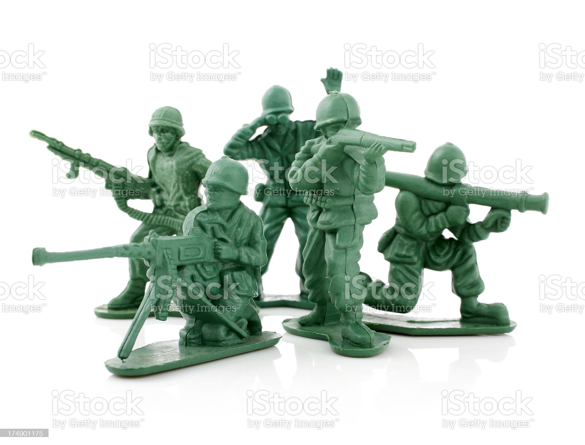 Four isolated toy soldiers on a white background royalty-free stock photo
