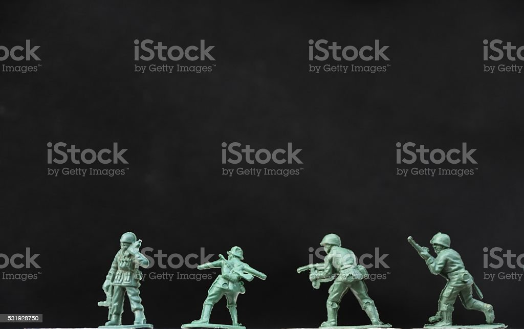 Four isolated toy soldiers stock photo