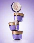 Four jars of cosmetic, moisturizing, anti-aging cream