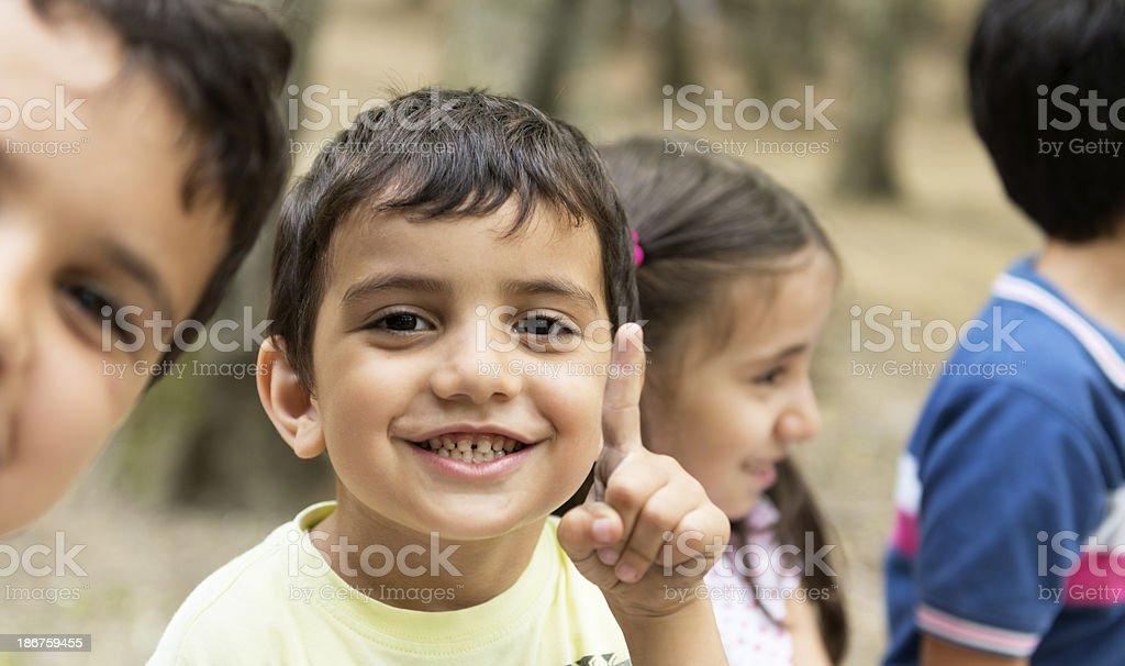 four kids at playground stock photo