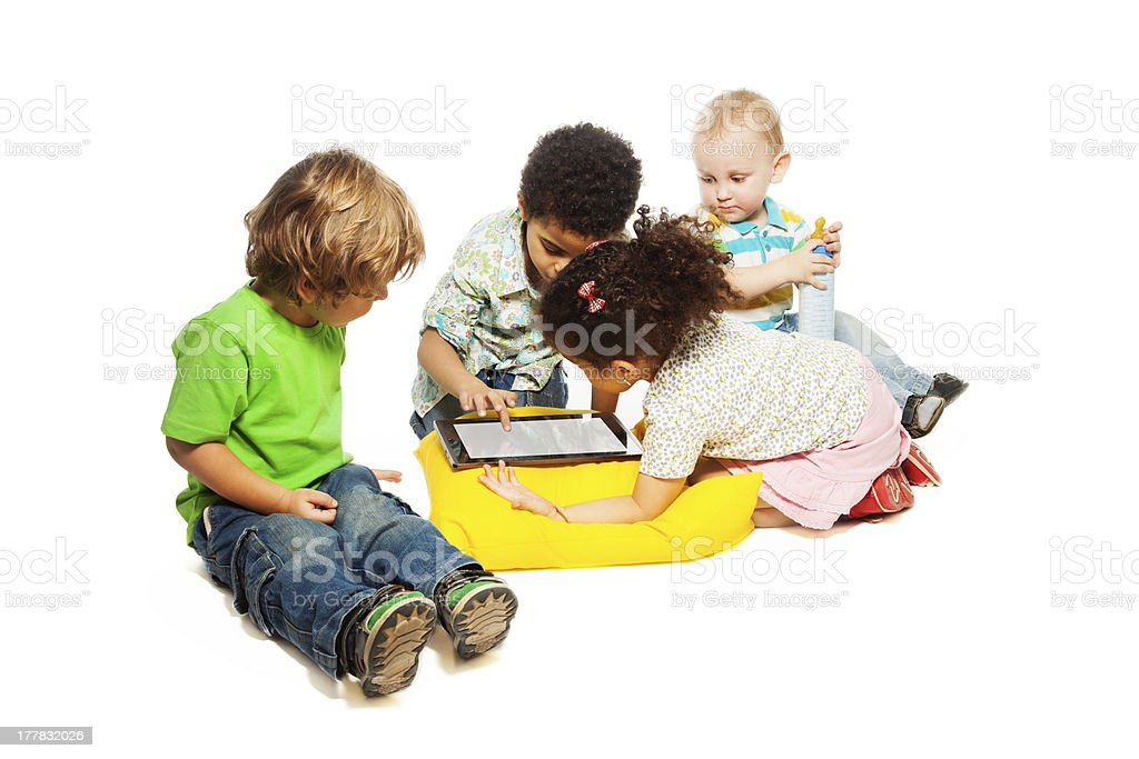 Four kids playing tablet computer royalty-free stock photo