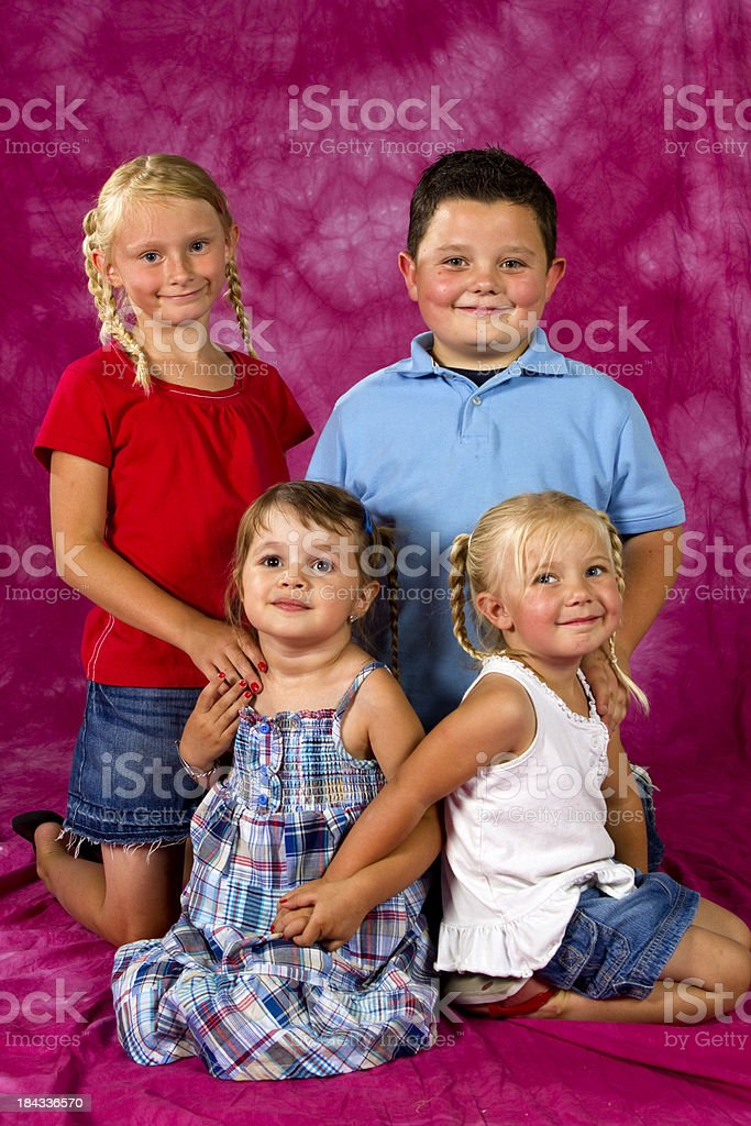 Four kids with great smiles stock photo
