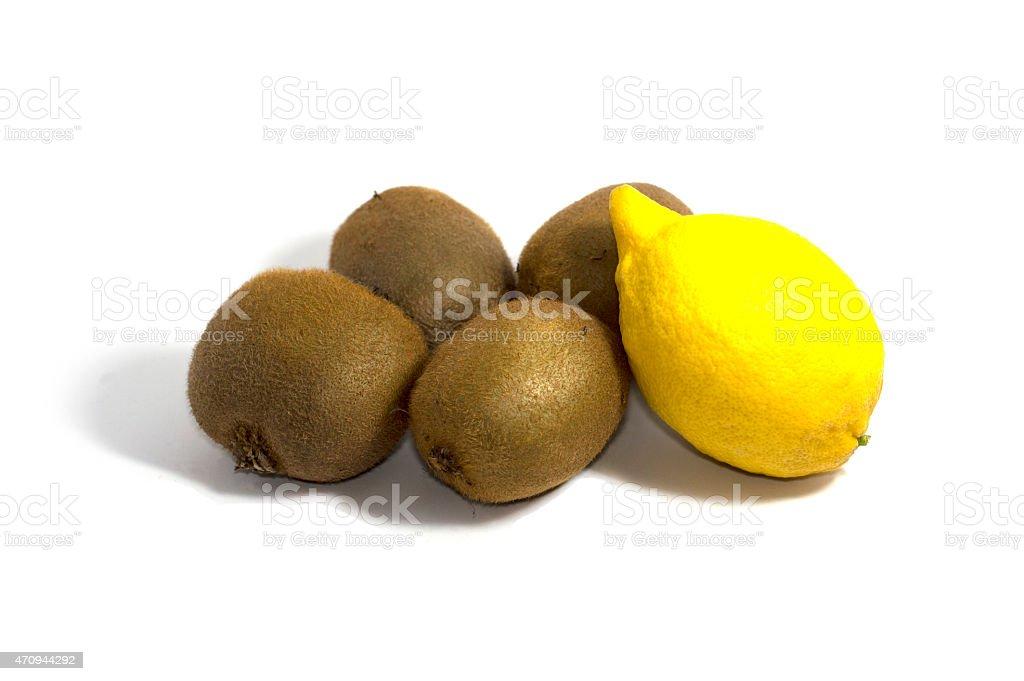Four kiwi and lemon on a white background, side view stock photo