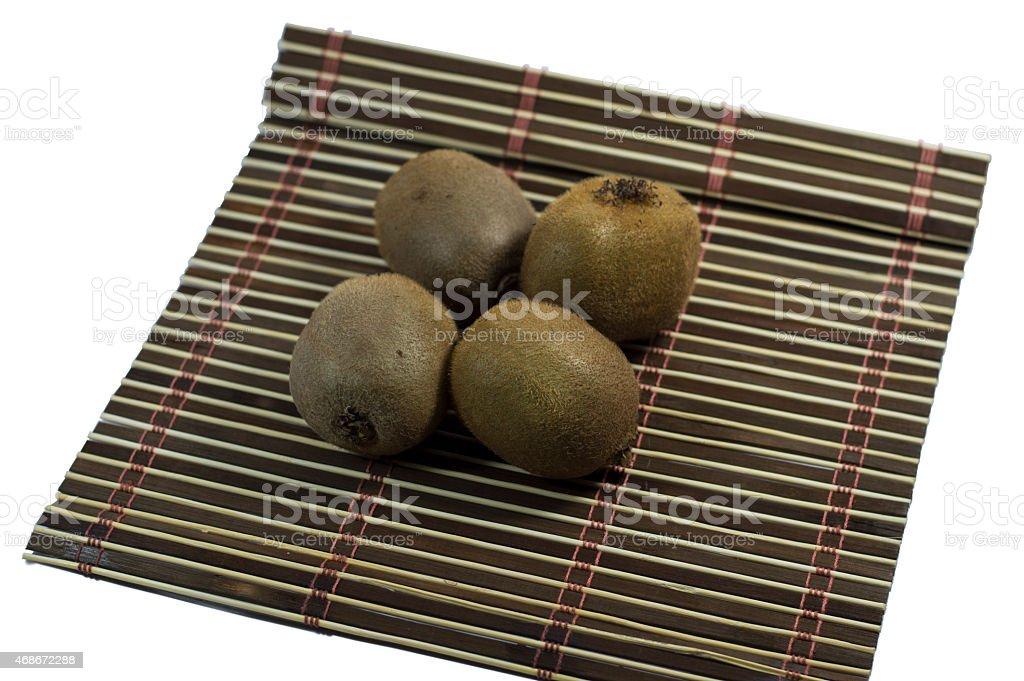 four kiwis on a rug stock photo