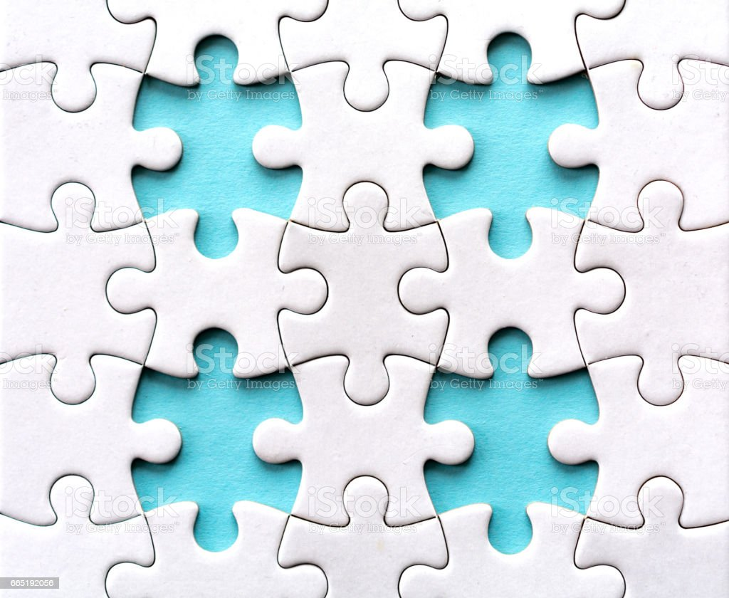 Four last pieces of a blank jigsaw puzzle stock photo