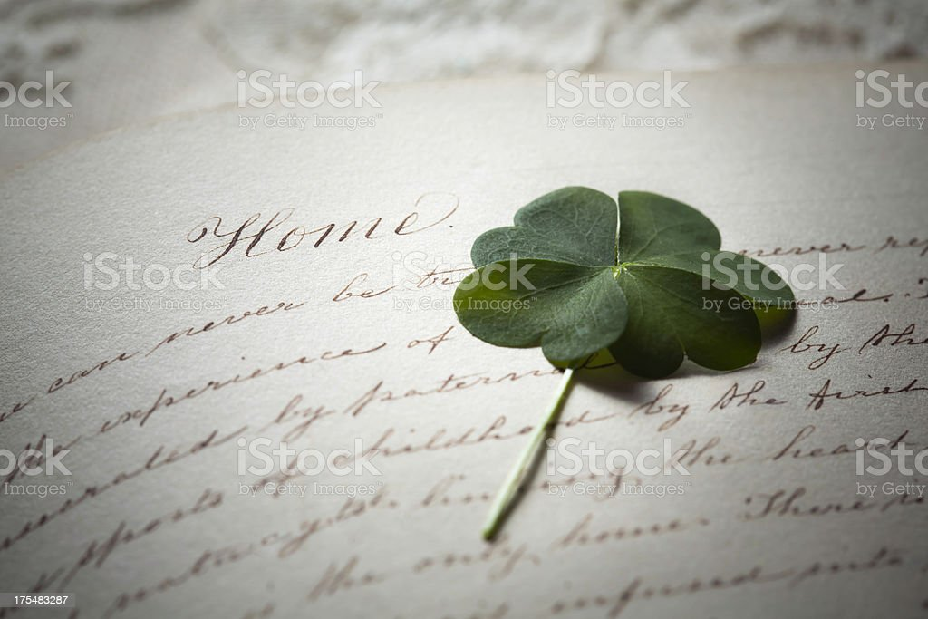 Four Leaf Clover in Old Diary royalty-free stock photo