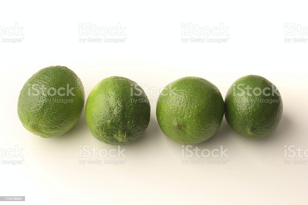 Four Limes on White Background stock photo