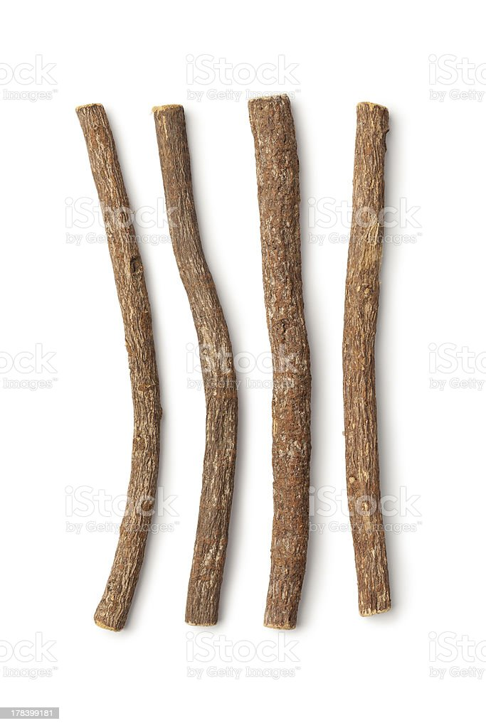 Four liquorice roots on a white background stock photo