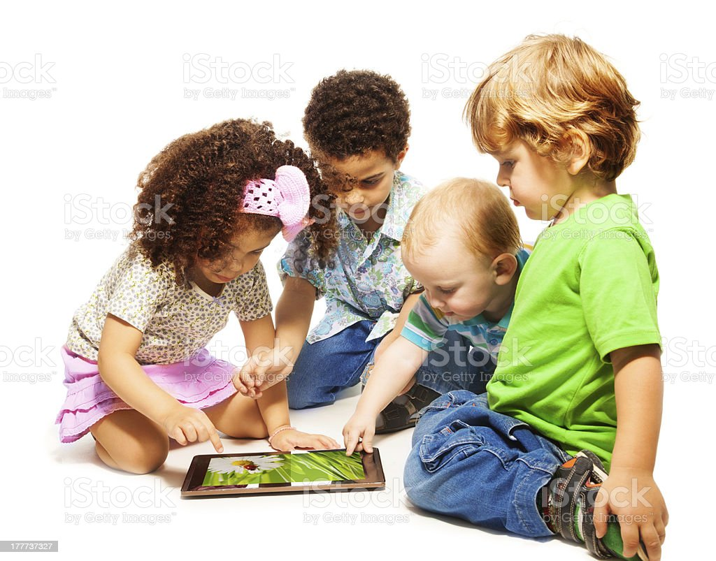 Four little kids playing tablet royalty-free stock photo