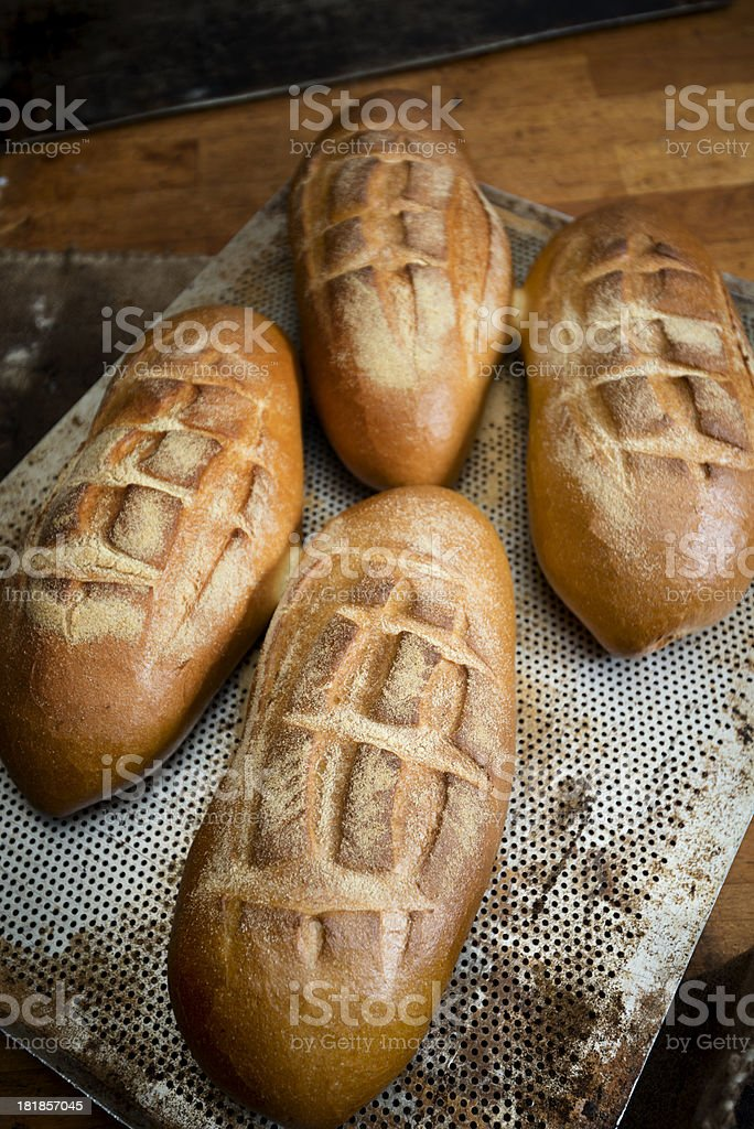 Four loafs of Artisan bread on metal tray royalty-free stock photo