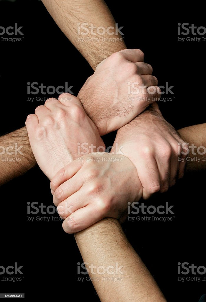 Four male hands holding pulses symbolizing union royalty-free stock photo