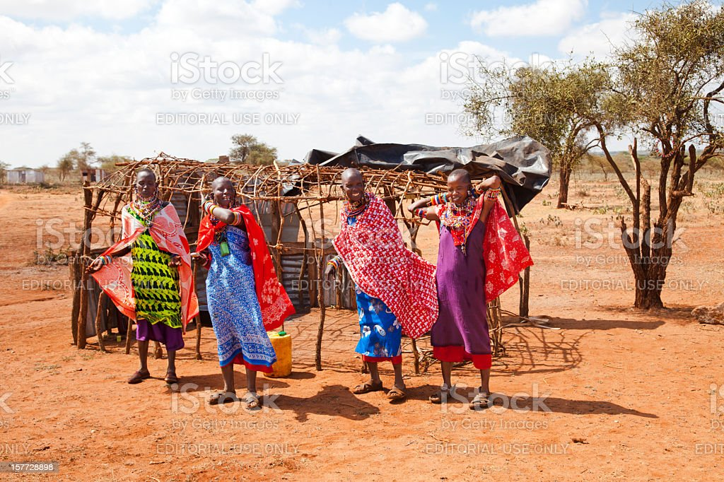 Four masai woman iin dry African landscape. stock photo